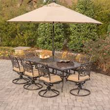 Swivel Patio Dining Chairs by Traditions Piece Dining Set In Tan With Eight Swivel Patio