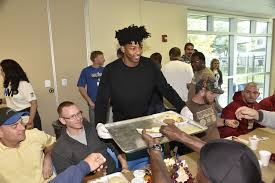 orlando magic players and employees served thanksgiving meals at