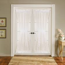 white lace curtains on glass sliding door with black metal handle
