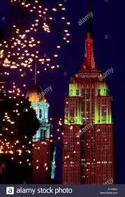 X Mas Tree View From Adorned Xmas Tree To Empire State Building At Night City