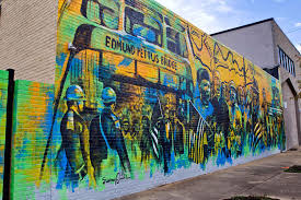 appalachian wins the camellia bowl artist sunny paulk s downtown montgomery mural which commemorates the 1965 voting rights march is visible on the wall of 129 montgomery street