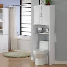 White Laminated Flooring White Wooden Bathroom Cabinet With Shelf Above White Toilet Bowl