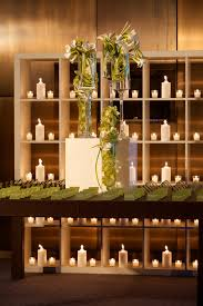 think green escort table with green escort cards and candle wall