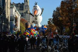 macy s parade rolls on with balloons bands security the boston globe