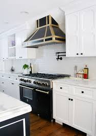 design manifest kitchen with black and brass hood and industrial