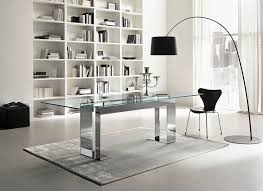dining table with glass top and metal base in chrome finish