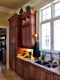 12 inch wide cabinet lowes best home furniture decoration kitchen design by scott herrin at lowe s island unit topped with wall pantry unit and kitchen sink area 12 foot ceilings schuler cabinetry design