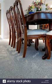 low angle view of a dining room table and floor stock photo