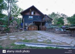 wooden country house with beutiful garden and flower decoration
