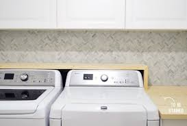 how to install a mosaic tile backsplash in the kitchen how to install a marble herringbone tile backsplash in the laundry