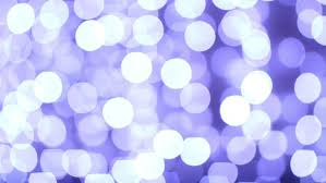 abstract background created by out of focus lights in blue white