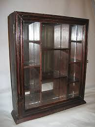 Wall Mounted Cabinet With Glass Doors by Nib Wood Curio Display Cabinet Glass Door Mirrored Back Wall Mount