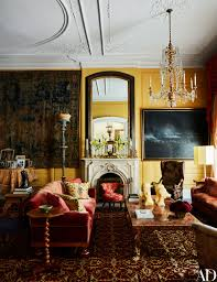 the living room boasts two grand fireplaces one shown