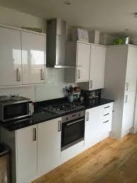 appliances glass kitchen backsplash also black granite countertop