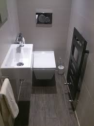 cloakroom bathroom ideas cloakroom with designer tile modern zehnder radiator wall hung