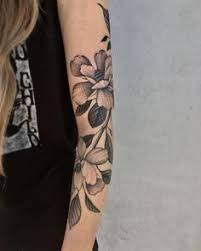 freehand magnolia by justin olivier at downtown tattoo new orleans