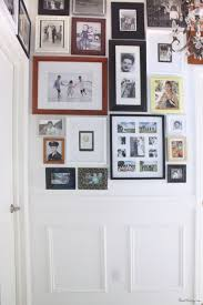 photo gallery collage covers entire hallway with family photos of