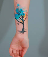 stunning watercolor tree design on wrist for