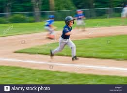 Home Plate Baseball by Young Boy Running From Third Base To Home Plate During A Little