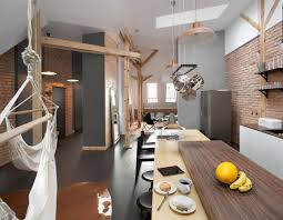 Brick Loft by Attic Loft Apartment With Brick Walls And Exposed Wood Poland 4