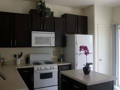 Kitchen Cabinets Redo by Dark Kitchen Cabinets And White Appliances Not Bad For The