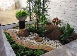 use the open area of the house by choosing unique rock garden