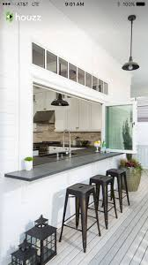 another example of the bar or kitchen opening to the outside