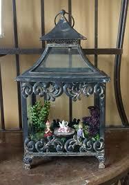 indoor mini fairy garden in a bird cage house toadstool mushroom
