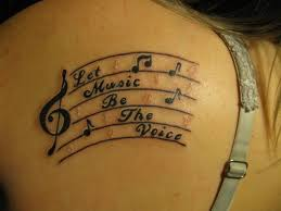 music note tattoos and other musician favorites thigh tattoo
