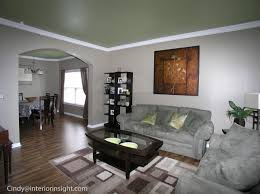 bright bold green ceilings play off the light grey walls in this