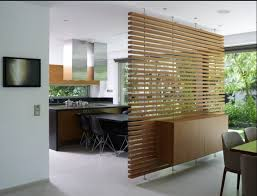 Luan Panels Covered With Decorative Vinyl Create A Moveable Partition Wall On Rollers For Functional