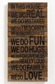 wall decor wood plaques loving this rustic wall with the quote in this house we