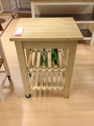 kitchen islands with wine racks small square maple wooden butcher block table on wheels with wine