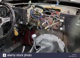 the dashboard wiring of a jaguar e type v12 at the repair shop of