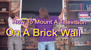 how to mount a tv on a brick wall youtube