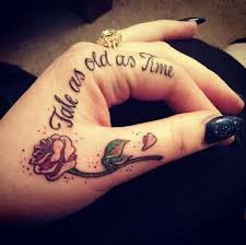 forearm quote tattoos tale as old as time u201d from beauty and the beast finger tattoos