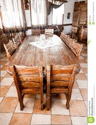 round table in dining room with wooden chairs stock photo image