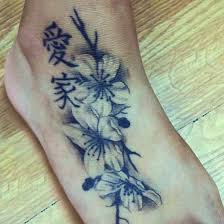 cherry blossom in black and white tattoos with my japanese name