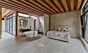 modern bedroom design light gray wood flooring beige wall color