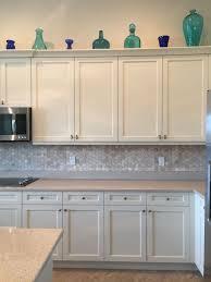 antique white kitchen craft cabinets installed a new kitchen backsplash crema royal 2 in