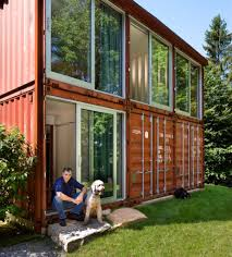 cute shipping container home with glass windows and simple sliding