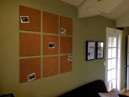 cork board tiles with polaroids for a photo wall all it needs now