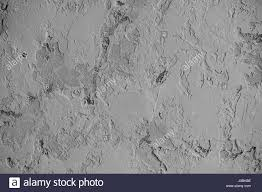Grey Textured Paint - grey wall with dabs of putty or paint texture or background stock