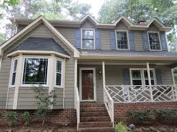 stucco exterior house paint colors and stone houses in