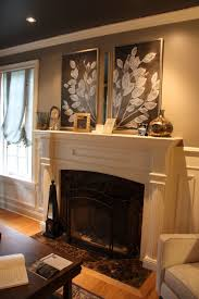 stately traditional home features elegant decor and latest trends the designer s mantel arrangement includes a thin strip of mirror between the paintings as a unique