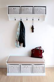 brilliant entryway storage design with wall mounted coat racks and