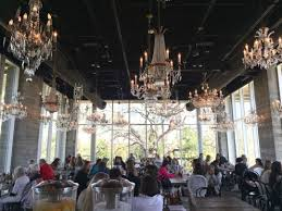 eat breakfast or lunch under a chandelier at the kitchen at the