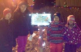 alexandria festival of lights many families are enjoying the storywalk activity at the festival of