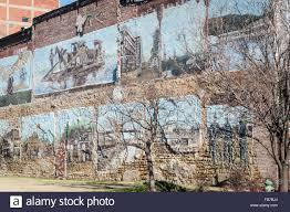 painted wall art murals depicting historic scenes in downtown painted wall art murals depicting historic scenes in downtown muskogee oklahoma usa