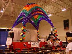 balloon palm trees with balloon arch for stage decorations party